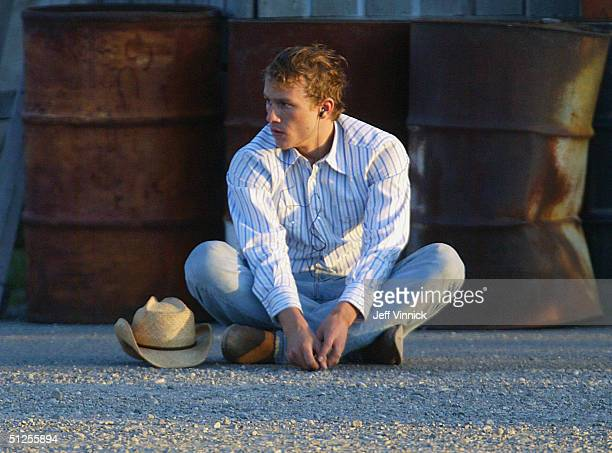 Actor Heath Ledger takes a break during filming of Brokeback Mountain June 1 2004 in Fort McLoed Alberta