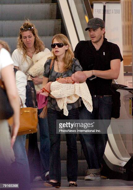 Actor Heath Ledger with wife Michelle Williams and daughter Matilda Rose Ledger leave Sydney International Airport for their New York home on January...