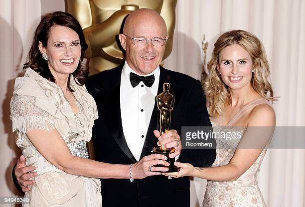 Actor Heath Ledger's mother Sally Bell left father Kim Ledger and sister Kate Ledger hold his Oscar for best supportingactor in the film 'The Dark...