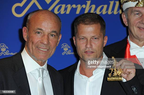 Actor Heiner Lauterbach and actor Til Schweiger pose with the KarlValentinOrden during the Narrhalla Soiree 2012 at Hotel Bayerischer Hof on January...
