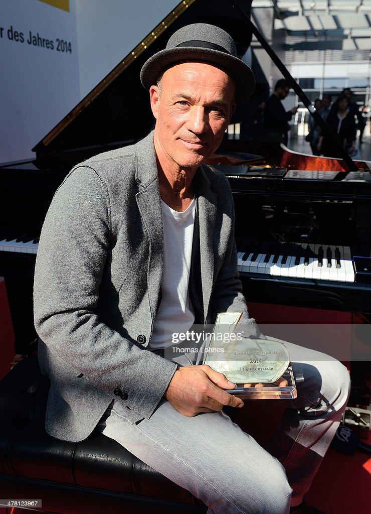 Actor Heiner Lauterbach poses with his 2014 Piano Player of the Year Award (Klaverspieler des Jahres 2014) on March 12, 2014 in Frankfurt am Main, Germany. Heiner Lauterbach (60) started playing the piano with his daughter Maya (11) three years ago and describes piano playing as 'super brain training'.