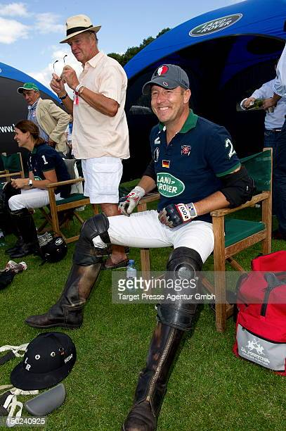 Actor Heino Ferch prepares for a polo match during the Engel Voelkers Berlin Maifeld Cup near Olympic Stadium on August 12 2012 in Berlin Germany
