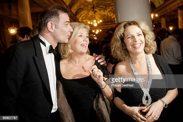 Actor Heinrich Schafmeister kiss actress Jutta Speidel and actress Michaela May at the afterparty of the Bavarian Movie Award 2010 at the...