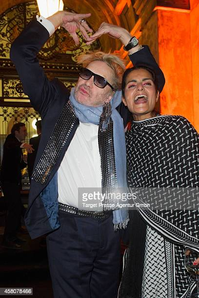 Actor Helmut Berger and designer Leila Piedayesh attend the 10th anniversary celebration of the Zoo Magazine at Naturkundemuseum on October 29 2014...