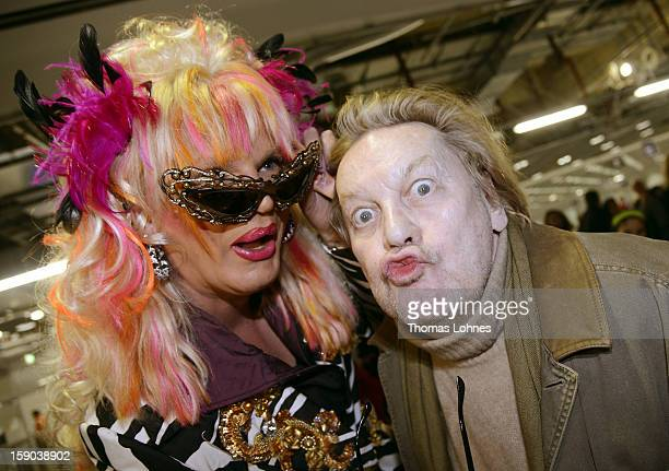 Actor Helmut Berger and Entertainer and DragQueen Olivia Jones pose for photographers in the Frankfurt airport before checking in for the flight to...