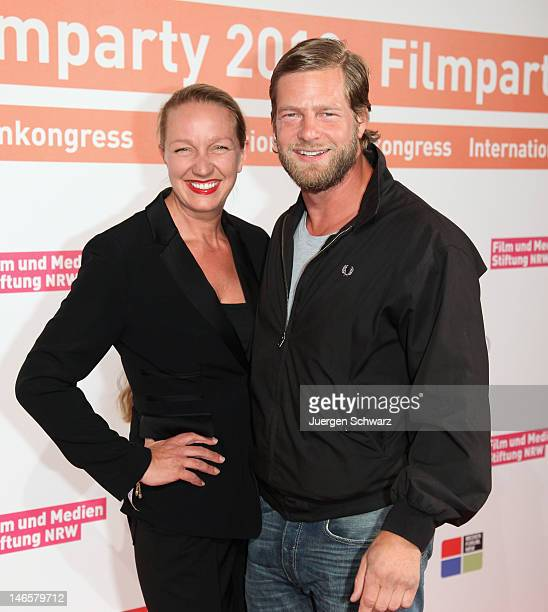 Actor Henning Baum and his wife Corinna pose during a photo call at the Filmparty NRW 2012 hosted by Film und Medienstiftung NRW on June 19 2012 in...