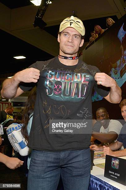 Actor Henry Cavill gets his tshirt signed by the cast of Suicide Squad film in an autograph session for fans in DC's 2016 ComicCon booth at San Diego...