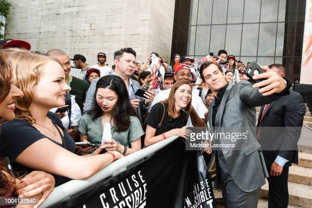 Actor Henry Cavill poses with fans during the 'Mission Impossible Fallout' US Premiere at Lockheed Martin IMAX Theater at the Smithsonian National...
