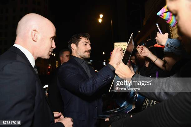 Actor Henry Cavill signs autographs for fans during the premiere of Warner Bros Pictures' Justice League at Dolby Theatre on November 13 2017 in...