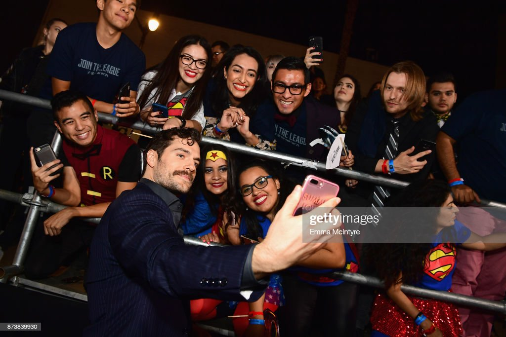 Actor Henry Cavill takes selfies with fans during the premiere of Warner Bros. Pictures' 'Justice League' at Dolby Theatre on November 13, 2017 in Hollywood, California.
