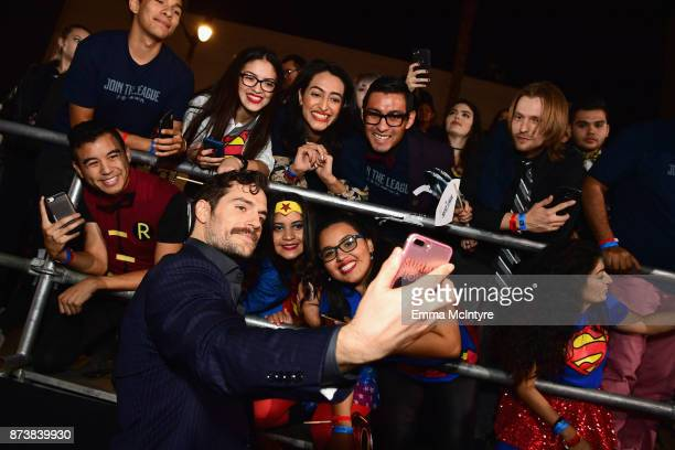 Actor Henry Cavill takes selfies with fans during the premiere of Warner Bros Pictures' Justice League at Dolby Theatre on November 13 2017 in...