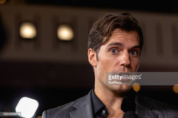 Actor Henry Cavill who plays quotAugust Walkerquot in Mission Impossible Fallout talks to reporters on the red carpet of the US premiere at the...