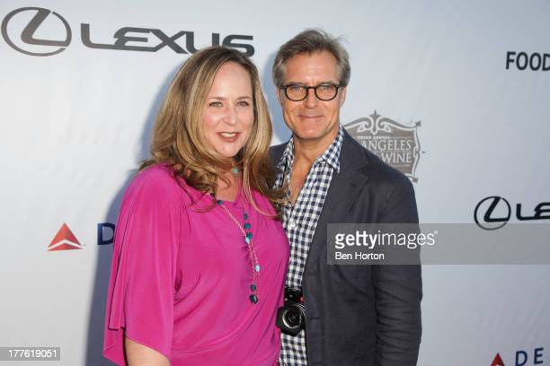 Actor Henry Czerny and his wife attend LEXUS Live on Grand hosted by Curtis Stone at the third annual Los Angeles Food Wine Festival on August 24...