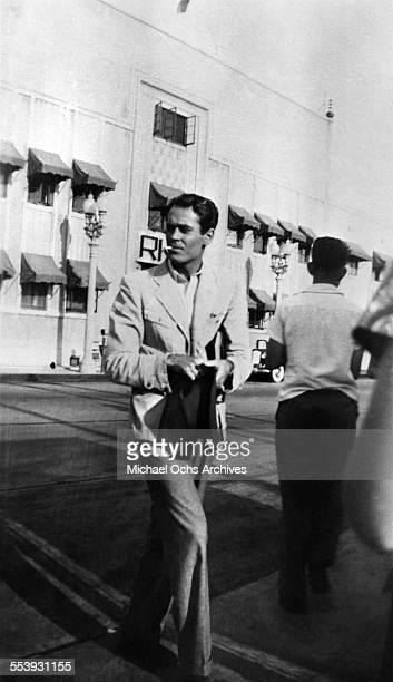 Actor Henry Fonda walks across the street outside the RKO studios in Los Angeles California