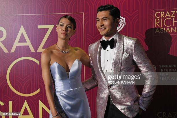 Actor Henry Golding and his wife Liv Lo arrive at the film premiere of 'Crazy Rich Asians' at the Capitol Theatre in Singapore on August 21 2018