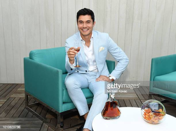 Actor Henry Golding toasts with Hennessy Paradis Imperial during an intimate dinner at The Penthouse at The London Hotel on August 3 2018 in West...