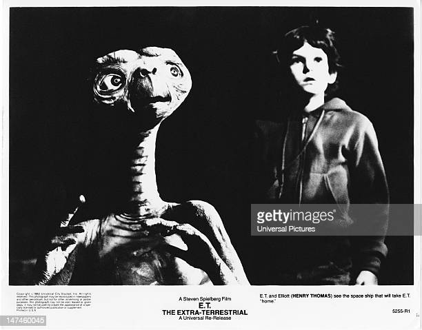 Actor Henry Thomas with his alien companion in a scene from the film 'ET The ExtraTerrestrial' 1982