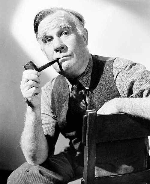 actor-henry-travers-smoking-tobacco-pipe