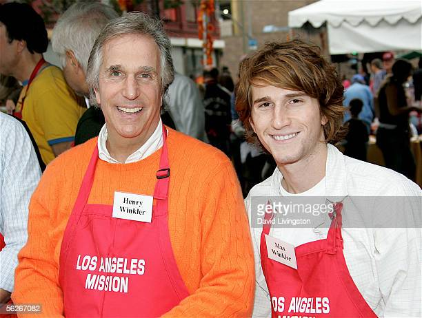 Actor Henry Winkler and his son Max pose between serving meals at the Los Angeles Mission and Anne Douglas Center's Thanksgiving Meal for the...