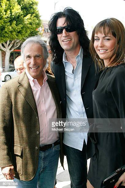 Actor Henry Winkler recording artist Tommy Thayer and his wife Amber attend 'A Plumm Summer' Premiere at the Mann Bruin Theater on April 19 2008 in...