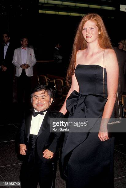 Actor Herve Villechaize and date Kathy Self attending the premiere of Licence To Kill on July 10 1989 at the Director's Guild Theater in Hollywood...