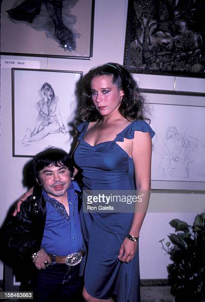 Actor Herve Villechaize and date Sharon Peters attending Celebrity Art Exhibit on March 14 1983 at the Central Art Gallery in Los Angeles California