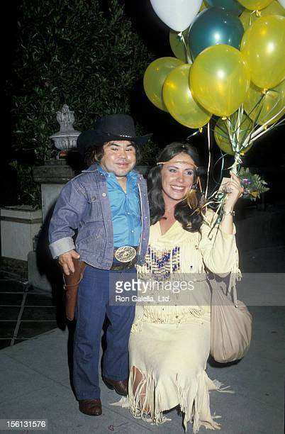 Actor Herve Villechaize and Tiffany Fallon attending 'Halloween Party' on October 31 1983 at Le Dome Restaurant in West Hollywood California