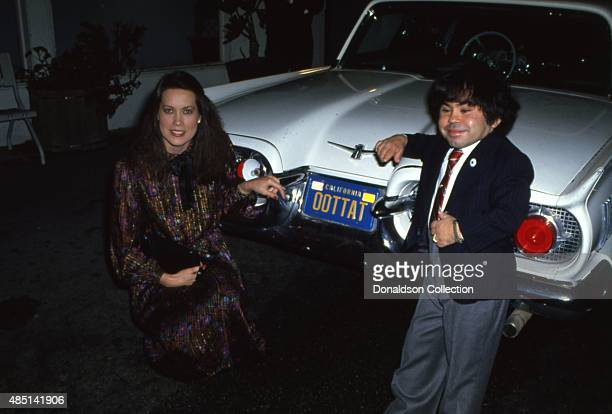Actor Herve Villechaize attends an event with a woman and his car that has the license plate OOTTAT a play on his name Tatu from the TV show Fantasy...