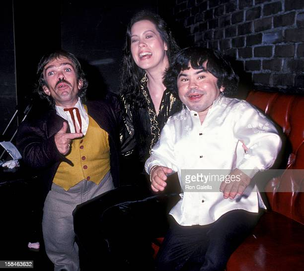 Actor Herve Villechaize wife Camille Hagen and Jon Edward Allan attending Party for Jackie Mason on September 14 1981 at the Improvisation in Los...