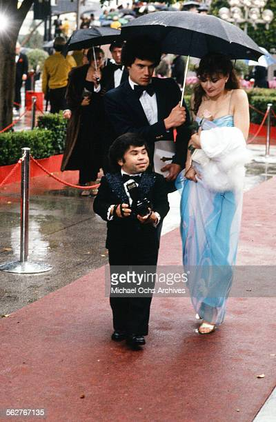 Actor Herve Villechaize with actress Kathy Self arrive to the 54th Academy Awards at Dorothy Chandler Pavilion in Los Angeles,California.