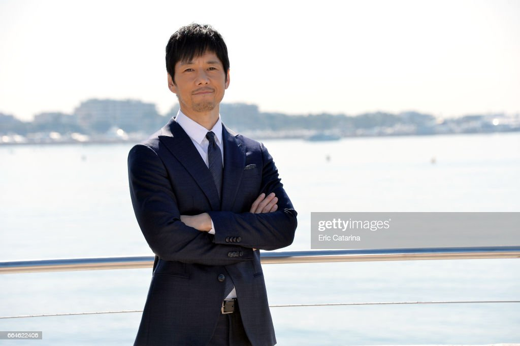 Actor Hidetoshi Nishijima attends the 'Crisis' photocall at La Rotonde on April 4, 2017 in Cannes, France.