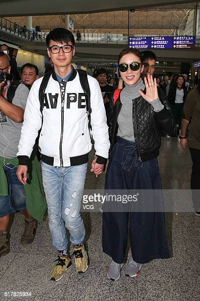 Actor Him Law and his wife actress Tavia Yeung arrive at the airport after registering for marriage in UK on March 27, 2016 in Hong Kong, China.