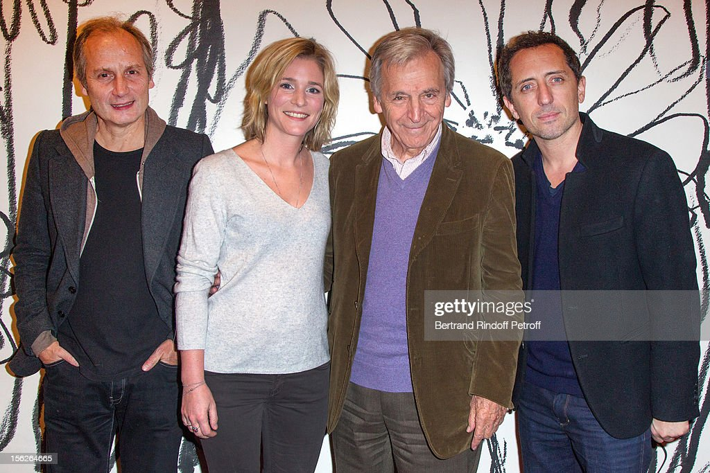 Actor Hippolyte Girardot, actress Natacha Regnier, Greek-born filmmaker Costa-Gavras (R) and actor Gad Elmaleh pose as they attend 'Le Capital' premiere at Gaumont Parnasse on November 12, 2012 in Paris, France.