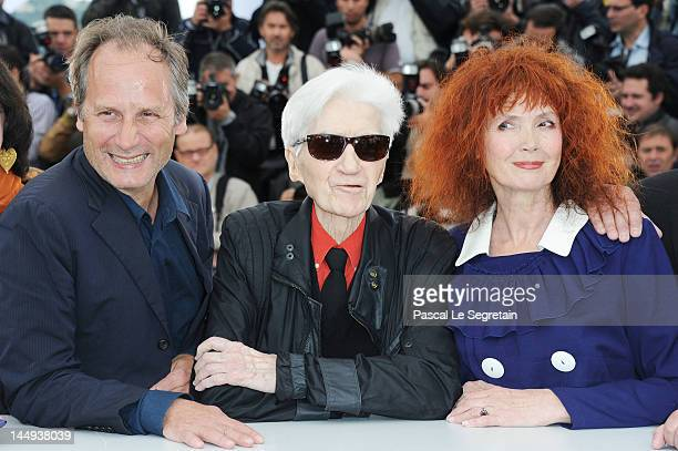 Actor Hippolyte Girardot director Alain Resnais and actress Sabine Azema pose at 'Vous N'avez Encore Rien Vu' Photocall during the 65th Annual Cannes...