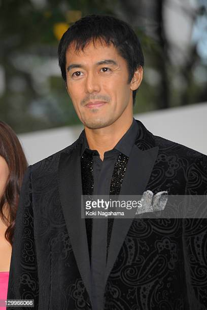 Actor Hiroshi Abe poses on the green carpet during the Tokyo International Film Festival Opening Ceremony at Roppongi Hills on October 22, 2011 in...