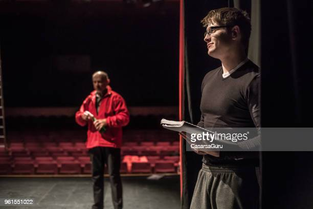 actor holding script during theatrical rehearsal - backstage stock pictures, royalty-free photos & images