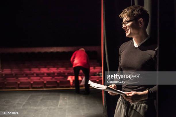 Actor Holding Script During Theatrical Rehearsal