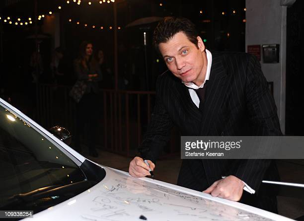 Actor Holt McCallany signs a Chrysler 300 as Vanity Fair Campaign Hollywood 2011 kicks off with Chrysler Celebrating 'The Fighter' held at the...