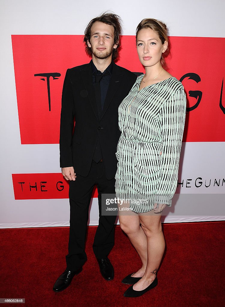 Actor Hopper Penn and Uma Von Wittkamp attend the premiere of 'The Gunman' at Regal Cinemas L.A. Live on March 12, 2015 in Los Angeles, California.