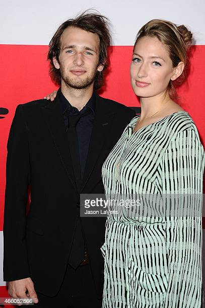 Actor Hopper Penn and Uma Von Wittkamp attend the premiere of The Gunman at Regal Cinemas LA Live on March 12 2015 in Los Angeles California