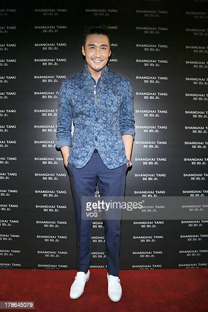 Actor Hu Bing attends Shanghai Tang store opening ceremony at Cathay Theater on August 29 2013 in Shanghai China
