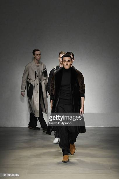 Actor Hu Bing walks the runway at the Consistence show during Milan Men's Fashion Week Fall/Winter 2017/18 on January 17 2017 in Milan Italy
