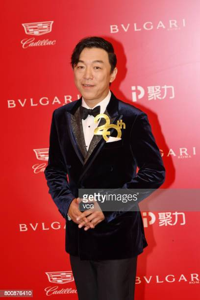 Actor Huang Bo poses on the red carpet of Golden Goblet Awards and Closing Ceremony of 20th Shanghai International Film Festival at Shanghai Grand...