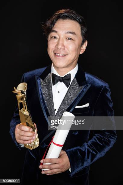 Actor Huang Bo poses with his trophy of the Award for Best Actor at the backstage of Golden Goblet Awards during the 20th Shanghai International Film...