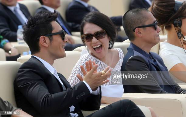 Actor Huang Xiaoming actress Zhang Ziyi and actor Tony Leung ChiuWai attend a launching ceremony for the Qingdao Oriental Movie Metropolis on...