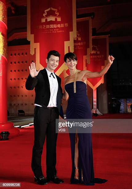 Actor Huang Xiaoming and actress Sophie Marceau arrive at the red carpet of the closing ceremony of the 3rd Silk Road International Film Festival at...
