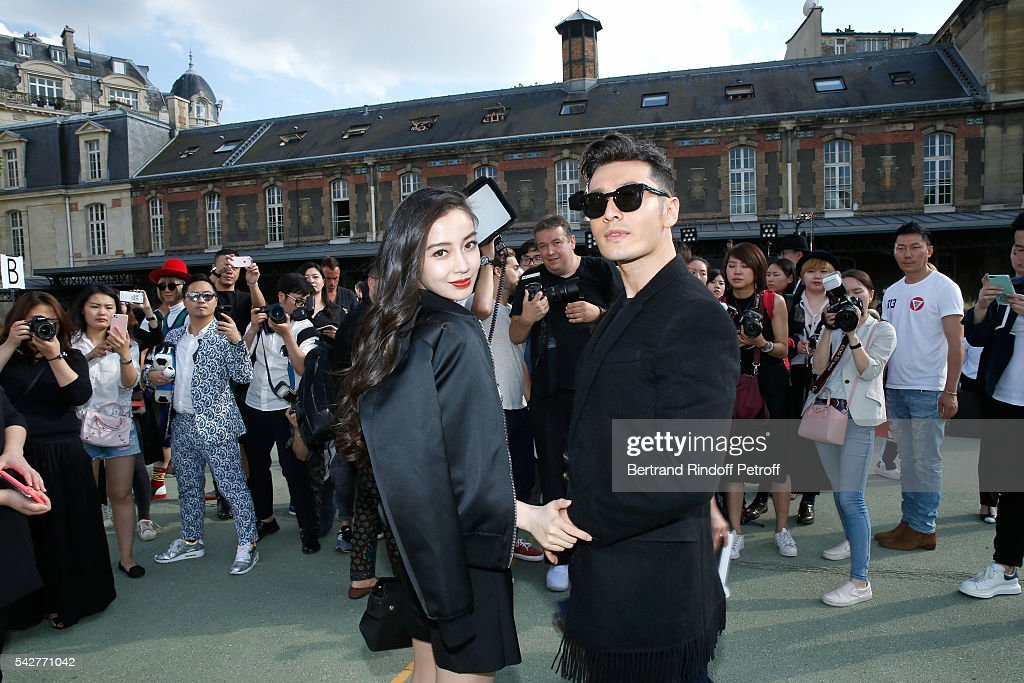 Actor Huang Xiaoming and his wife model Angelababy attend the Givenchy Menswear Spring/Summer 2017 show as part of Paris Fashion Week on June 24, 2016 in Paris, France.