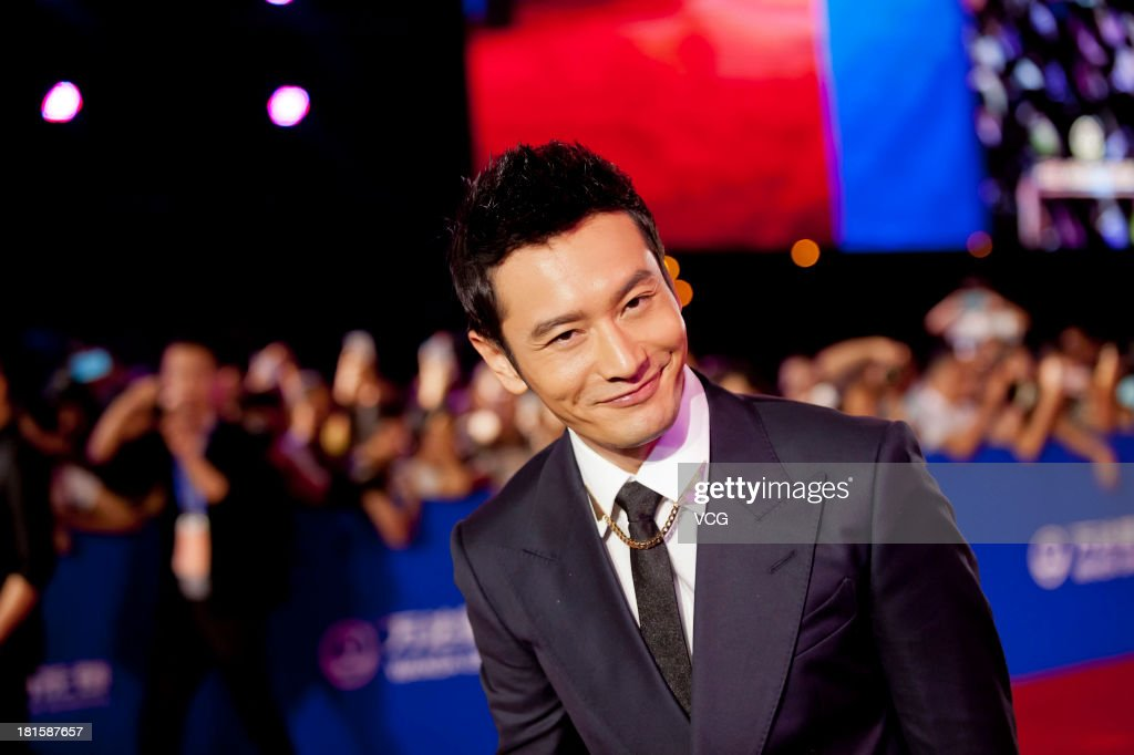 Actor Huang Xiaoming arrives at the red carpet during the opening night of the Qingdao Oriental Movie Metropolis at Qingdao Beer City on September 22, 2013 in Qingdao, China.