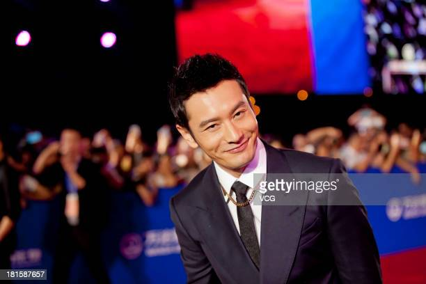 Actor Huang Xiaoming arrives at the red carpet during the opening night of the Qingdao Oriental Movie Metropolis at Qingdao Beer City on September 22...