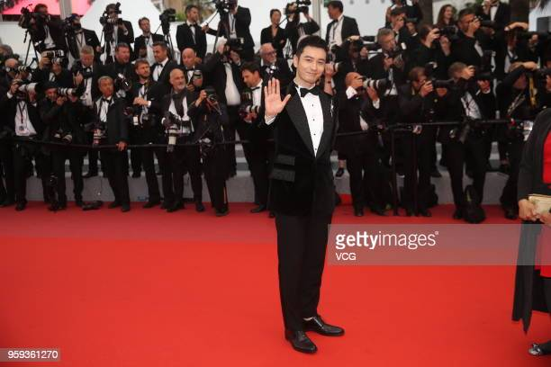 Actor Huang Xiaoming attends the screening of 'Burning' during the 71st annual Cannes Film Festival at Palais des Festivals on May 16 2018 in Cannes...